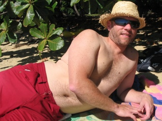 Steve trying to get a tan way too quickly, in Ellis Beach, Tropical North Queensland.