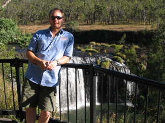 Steve posing in front of the Millstream Waterfalls, in Tropical North Queensland.