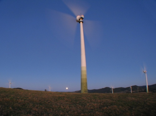 A beautiful site of the Wind Mill, with the full moon rising behind.
