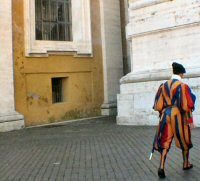 Looking more like a court jester, one of the Swiss Guards who guard the Pope.