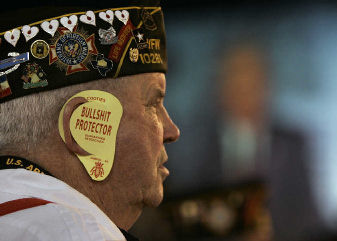 this is what the US War Veterans are wearing to George W's speeches.