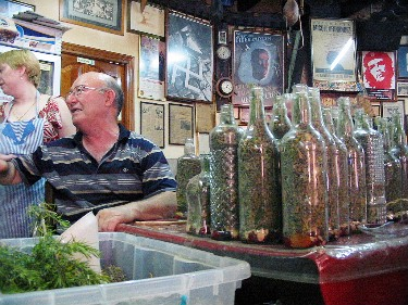A publican in one of the small mountain villages, preparing his secret herbal panacea.