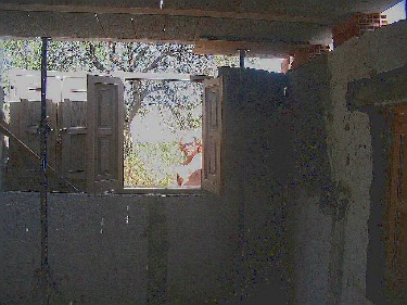 My first job was to bust a hole in the kitchen wall to fit two windows.