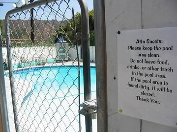 The pool is deserted in the middle of the day. I find that the gate is actually locked.