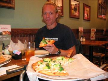 Me, enjoying a delicious but unusual chicken and broccoli pizza, and looking somewhat like a transexual.