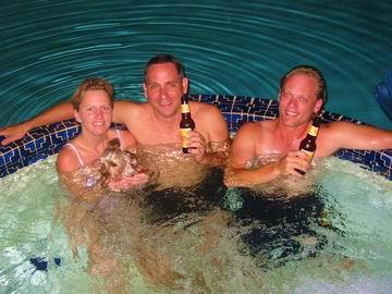 Suzan, Tim and I enjoying the hot tub. Ziggy enjoying it slightly less.