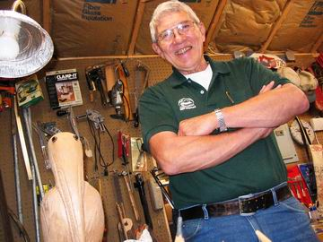 Chuck showing me around his home timber workshop, and the pelican he carved as a gift for a friend.