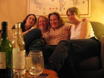 A blurry photo of Nicole and a few of her friends. At least the wine bottles were in focus!.