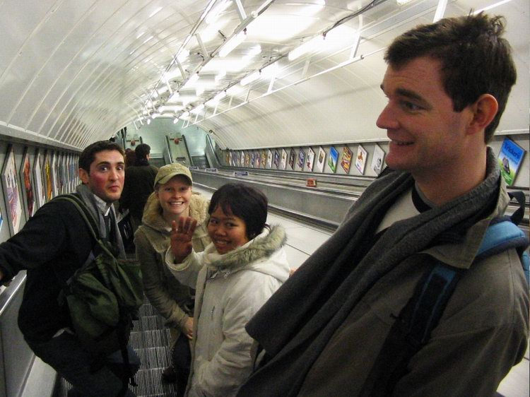 Rob, Michelle, Mai and Andy on the escalator at the tube station