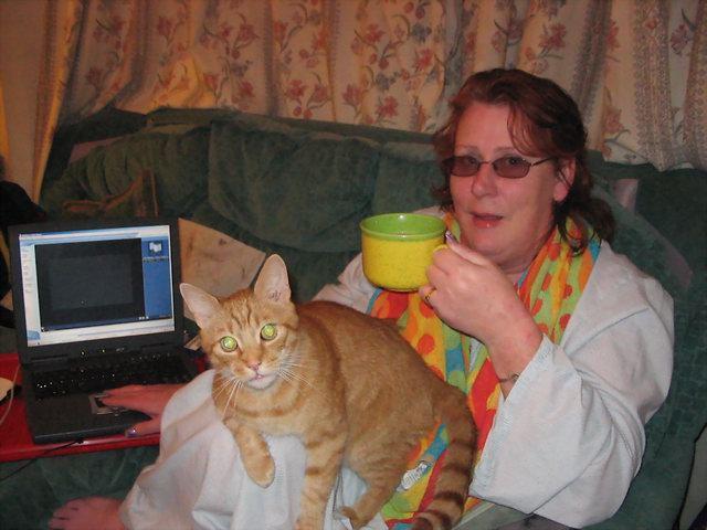 Ann and her three legged cat Peggatty.
